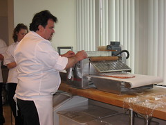Pierre Hermé: Passing the tomato puff pastry through the sheeter machine (another view)