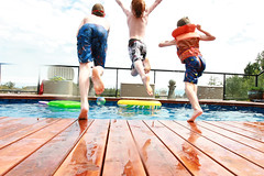Geronimo!! (CrzysChick) Tags: friends summer motion reflection wet water pool swimming swim fun three jump jumping movement action midair geronimo