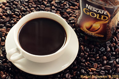 NESCAFE GOLD (Mashael Al-Shuwayer) Tags: cup coffee digital canon eos gold nescafe kartpostal 400d diamondclassphotographer flickrdiamond mashael alshuwayer