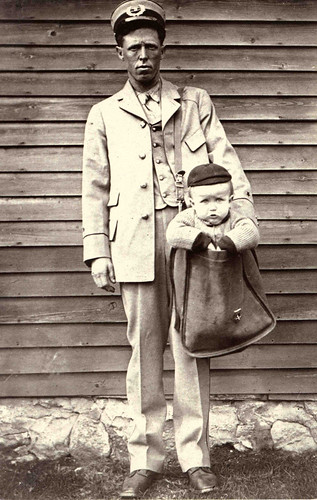 Uniformed Letter Carrier with Child in Mailbag, by Unidentified photographer, c. 1900, National Postal Museum.