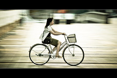 Horizontals: Girl on a bicycle (manganite) Tags: girls people motion blur color topf25 colors fashion bike bicycle japan sepia digital geotagged asian japanese high blurry topf50 nikon topf75 key colorful asia tl framed candid young teens teenager  nippon desaturated d200 nikkor dslr topf150 toned panning topf100 nihon kanto tsukuba ibaraki japanesegirl fav100 supershot 18200mmf3556 utatafeature manganite nikonstunninggallery ipernity abigfave date:year=2006 date:month=july date:day=10 geo:lat=36081743 geo:lon=140113508 format:orientation=landscape format:ratio=21