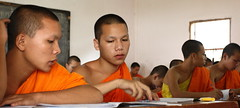 at the novice school (detengase) Tags: boy orange colour boys colors canon eos asia asien southeastasia prayer religion culture monk buddhism unesco monks tradition laos luangprabang offerings alms moine louangphrabang novices northernlaos theravadabuddhism