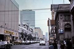 gm_08723 Yonge Street at Queen St., Toronto 1980 (CanadaGood) Tags: toronto ontario canada color colour building clock analog traffic slidefilm streetphoto kodachrome eighties 1980 on canadagood slidecube