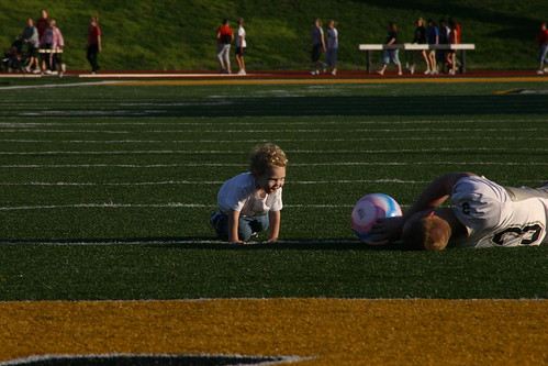 "Landon Dody plays catch with junior Danny McEvoy Tuesday night during ""Laps 4 Landon"" at Welch Stadium. The event, which is named in his honor and held to raise money for Cystic Fibrosis research, raised approximately $2,700. Kellen Jenkins/The Bulletin"