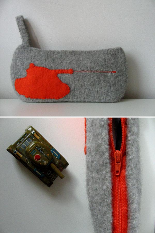 orange tank/ grey clutch