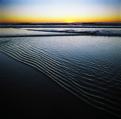When the ocean waves... wave back (Zeb Andrews) Tags: ocean blue sunset beach lines oregon square coast surf waves pacificocean pacificnorthwest arcadiabeach hasselblad500c bluemooncamera zebandrews blownhighlightsanddarkareaswithlittledetailarefabulous stoppingbytheoceanonawarmevening zebandrewsphotography