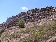 Gary coming down rock scramble on ridge