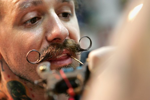 He completed 415 tattoos in 24 hours. (AP Photo/ Dallas Morning News,