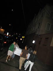 Friends make light of hauling our mattress through The Mission, San Francisco