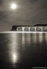 Reflecting (~Glen B~) Tags: bw cliff moon white black beach silhouette reflections coast pier coastal shore duotoned saltburn huntcliff coastine