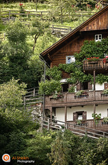 Austrian House - Hallstatt Salzkammergut (Essa Al-Sheikh - @Bo3awas) Tags: old flowers houses summer salzburg canon linz austria countryside is sterreich perfect photographer upper valley land l 2008 f28 photograpy 70200mm the alsheikh eissa hallstatt xti of 400d platinumphoto visiongroup salzgammergut