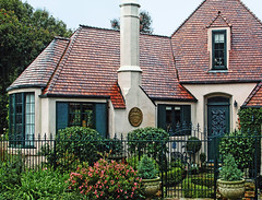 Once Upon A Time (linda yvonne) Tags: french norman murphy wroughtironfence interestingness162 i500 storybookstyle storybookhomes lindayvonne carmelcottage hasenyagerhouse roomswithboxwoodwalls renaissancemedaillion meticulouslandscaping whimsicalhomes