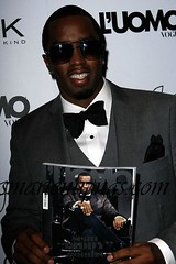 diddy holding a magazine