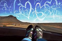 the heart sock phenomenon continues... (janoid) Tags: trip sky car socks hearts onthewayhome xoxoxoxox saturdaysilliness heartsocks loveyousweetie fromseeingthefamilyinsoutherncaliforniaforthanksgiving buteverytimeiseethebeautyofthisincredibleworlditneverfailstotakemybreathaway luckilyitdidntknockmysocksoff wegothomeabouteighthourslater whenwewerealltootiredandcrankytonoticemuchofanythingbesidesourbeds somewhereoutsideoflasvegas ihaddrivenforabout5hoursandthiswasmyturntolookattheworldwithmyheartsocks ihavetosayiwasntassurprisedasiwasinthepast