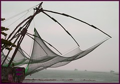 chinese fishing-nets in the rain (hatschiputh) Tags: wet train chinese kerala kochin fishingnet goldstaraward
