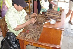 Cigar Maker (cwgoodroe) Tags: blue food beach beer pool mexico sand surf markets palmtrees bowls zihuatanejo infinitypool fishingvillage trinkets tacostand cervesa sfchronicle intrawest zihua zhihua outdoormarket 96hrs playadelropa