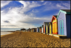 Brighton Bathing Boxes (Luke Tscharke) Tags: houses sky beach water clouds digital canon geotagged eos bay sand warm brighton australia melbourne victoria explore boxes colourful bathing xsi brightonbathingboxes explored brightonbeachhouses 450d canonefs1855mmf3556is digitalrebelxsi lushaki geo:lat=37919995 geo:lon=144987486 luketscharke