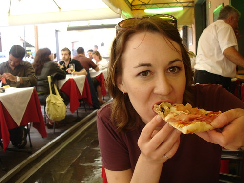 Kari sinks her teeth into a big Pisa pie.