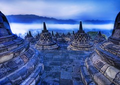 The Rolling Buddhist Morning Mist (Stuck in Customs) Tags: blue panorama white monument colors lines bells work painting indonesia photography nikon perfect exposure shoot photographer shot angle image bell photos buddha buddhist details d2x perspective picture blues atmosphere edge pro meditation portfolio jogjakarta inspirational capture hdr borobudur highquality treysalbum stuckincustoms treyratcliff burubudur