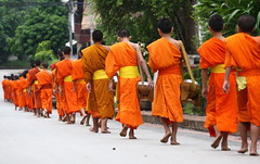 the novices are departing... (detengase) Tags: orange colour feet colors canon foot eos asia asien southeastasia prayer religion culture monk buddhism unesco monks barefoot tradition laos luangprabang offerings alms moine louangphrabang novices northernlaos theravadabuddhism