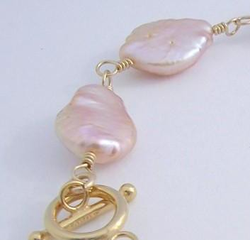 A refined combination of natural pink-toned freshwater pearls and 12ct gold fill - limited edition