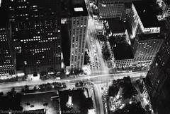 Michigan and Chestnut (LionTX) Tags: street urban bw white chicago black building tower film water skyscraper fire illinois downtown observatory chestnut hp5 hancock ilford 1871 canonelan7 canonef50mmf18ii
