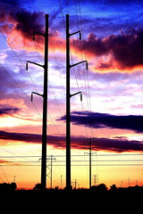 A powerful sunset (Nick, Programmerman) Tags: sunset clouds powerlines 24105 powerpoles overcontrasted 1dii