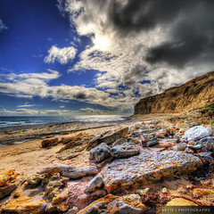 Brewing Storm :: HDR | Vertorama (:: Artie | Photography :: Cya in Sept!) Tags: sea sky cliff sun clouds photoshop canon dark rocks cs2 cloudy earth tripod australia melbourne wideangle stormy victoria soil 1020mm raining hdr artie maslin 3xp sigmalens photomatix tonemapping tonemap 400d rebelxti maslinbeach vertorama