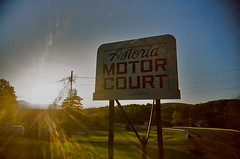 far from astoria (Gigi Elmes) Tags: sunset usa newyork film spring kodak motel expired vivitar uws oldsign catskill sunflare ultramax flarewhore gigielmes astoriamotorcourt