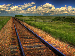Blue Sky on Rails (ecstaticist) Tags: railroad blue sky cloud white green grass rock stone stones fluffy rail casio alberta hdr gravel cs3 photomatix tonemapped tonemapping tonemap platinumphoto superaplus aplusphoto exf1