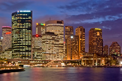 Circular Quay and Colourful Sydney Skyline at Night (Craig Jewell Photography) Tags: city travel sunset sky cloud color colour reflection water skyline architecture modern night buildings lights boat twilight colorful cityscape nightscape cloudy harbour dusk sydney australia circularquay quay multipleexposure newsouthwales colourful circular multiexposure aficionados pentaxk10d justpentax craigjewellphotography