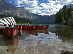 Yoho Canoes (Lumatic) Tags: park sky lake canada mountains reflection tourism nature topv111 clouds digital landscape rockies boats photography freedom boat photo nationalpark scenery flickr bc crystal photos britishcolumbia turquoise picture paddle 100v10f calm canoe clear explore canoes online boating rockymountains np canoeing watersports boathouse paddling emerald digitalphoto digitalphotos yoho calmness watersport emeraldlake canadianrockies yohonationalpark lotse paddler tranquill lakeemerald mountburgess photosonline photoonline lumatic