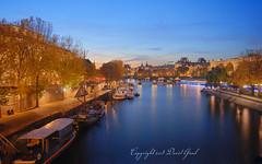 Blue Hour on La Seine and le Pont des Arts DRI (David Giral | davidgiralphoto.com) Tags: bridge blue david paris france seine river boats golden nikon louvre arts sigma bateaux rivière hour d200 1020mm pontdesarts sigma1020mm giral nikond200