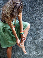 Adornments (Andria Solha) Tags: woman color green colors hair foot leg gray longhair balls auburn bracelet adorn adornment wicks wavyhair redhaired curledhair coloredballs graywall hairwavy anklesupport andriasolha acsolha skirtgreen