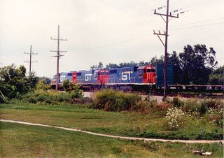 Speeding northbound Grand trunk Western freight train. Alsip Illinois. August 1990. by Eddie from Chicago