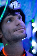Exploring the silver tree (skinr) Tags: white guy night blackrockcity fascination headlamp glowstick bluetree artinstallation wideeyed fascinated silvertree theamericandream burningman2008 burnerportrait wwwjskinnerphotocom jasonjamesskinner