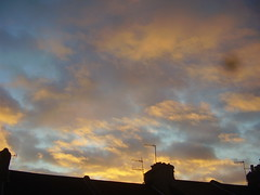 Yellow clouds and rooftops (the_dan) Tags: blue sunset sky yellow clouds brighton rooftops chimneys antennas