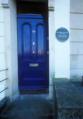 Photo of Randolph Sutton green plaque