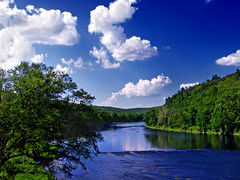 River View (Nicholas_T) Tags: sky newyork clouds spring pennsylvania brightlight cumulus creativecommons pikecounty delawareriver roeblingbridge sullivancounty lackawaxentownship upperdelawarescenicandrecreationalriver roeblingsdelawareaqueduct