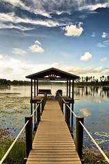 Path to the Dock (HDR) (crashmattb) Tags: sky lake water tampa dock chair florida alice odessa plugin hdr canoneosdigitalrebelxti platinumphoto anawesomeshot sigma1770mmf2845dc adobephotoshopcs3 redynamix dcetools medichance