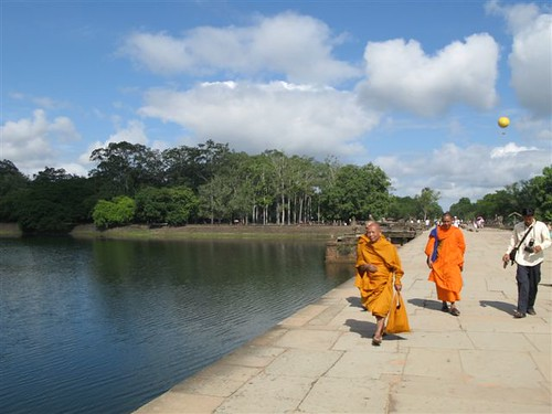 monks on the path leading to Angkor Wat