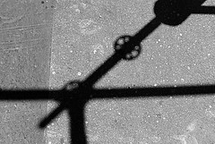 shadow / 1 (christing-O-) Tags: shadow blackandwhite black ski grey noiretblanc pavement circles angles immeuble chezmoi ravalement btons anawesomeshot