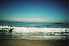 Crash (R.A.Jimnez) Tags: ocean blue sky brown green water 35mm crossprocessed sand surf bright tide sunny breeze olympusxa2 walgreens cloads fujicolorsensia400isoslidefilm