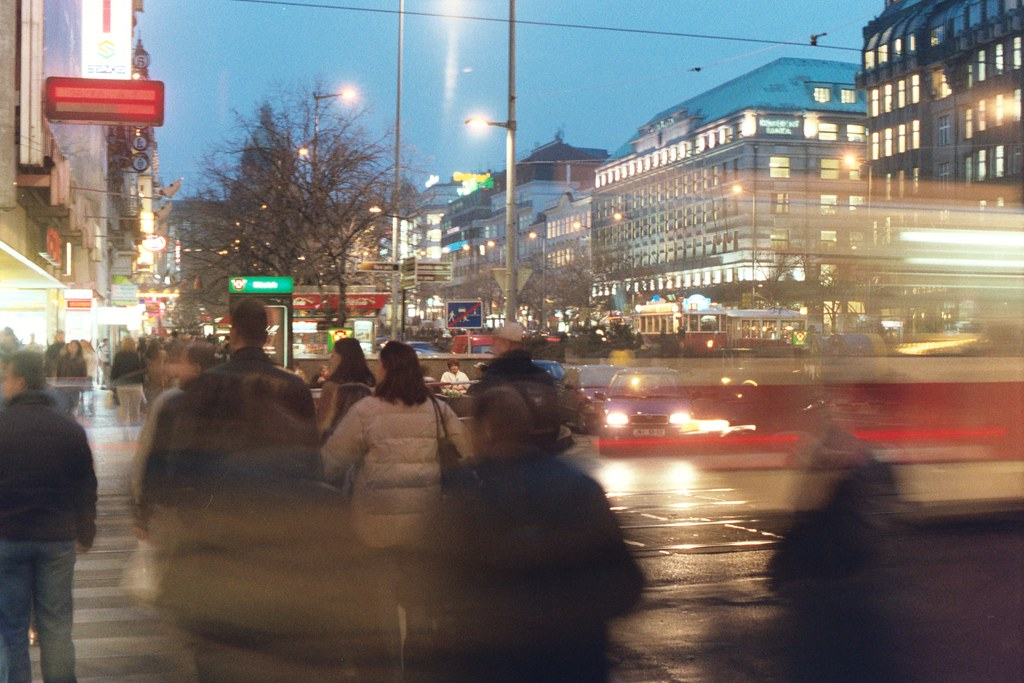 Prague 2002: night time street view of people, a tram, etc; I like this one
