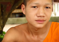 portrait of a novice (detengase) Tags: boy orange colour boys colors canon eos asia asien southeastasia prayer religion culture monk buddhism unesco monks tradition laos luangprabang offerings alms moine louangphrabang novices northernlaos theravadabuddhism