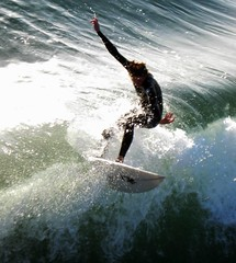 Flying high at Pacific Beach, Surfing's Best San Diego, (moonjazz) Tags: california sea white male guy fall classic beach sports wet water concentration intense force power ride control arm pacific sandiego superb great smooth wave surfing crest best foam zen rush surfboard effort balance swift form sure excitement inspire wetsuit thrill mywinners thesuperbmasterpiece