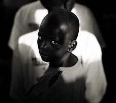 L'afrique nous regarde (hippolyte photography) Tags: africa boy bw eye look 21 papa senegal xxi regard afrique eos5d