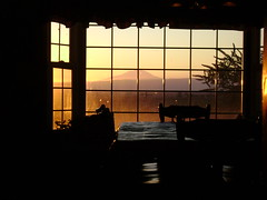 The Sun Sets (brendanshearer) Tags: window lamp reflections butterfly table bay bush mt adams chairs silhouettes dine