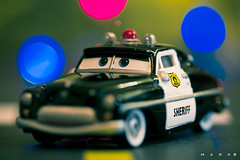 when it comes to driving, be CAReful this holiday (marker (mark®)) Tags: christmas blue light red holiday cars yellow canon toy navidad luces interestingness dof purple bokeh violet fiestas police disney amarillo pixar policecar animated sheriff violeta juguete diecast disneypixarcars platinumheartaward