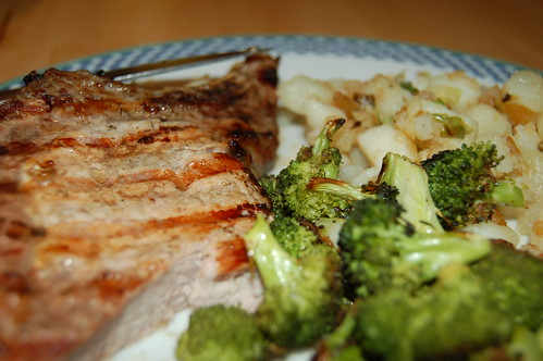 Greek pork chop, fried potatoes, roasted broccoli